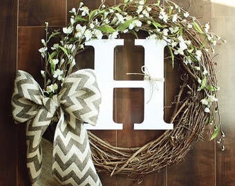 Monogrammed Grapevine Wreath with white cherry blossom details intertwined & a Chevron Bow