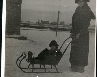 vintage photo Mother Pushes Child Sleigh in Snow 1915