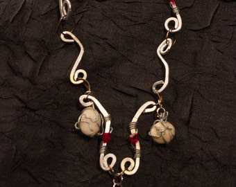 Silver Hammered Wire Ruby Swarovski Crystals and Beach Stone Necklace