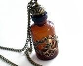 Poison Bottle Pendant with Skull and Crossbones
