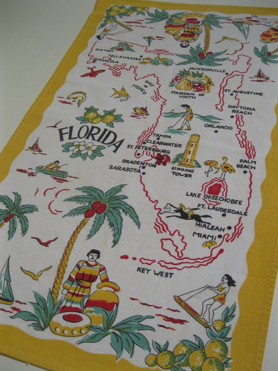 Vintage 1940s Florida souvenir tea towel with palm trees and airplane - yellow