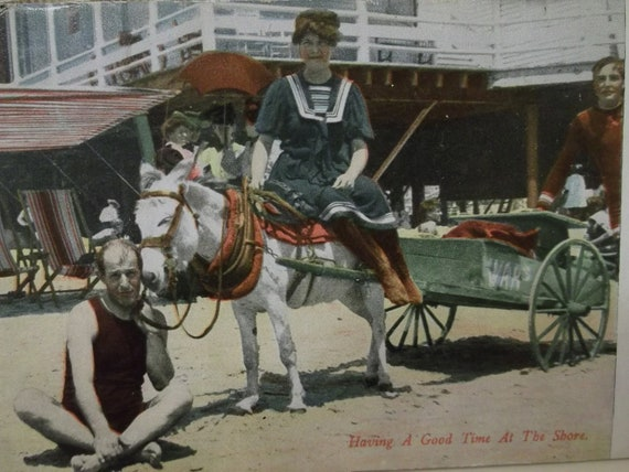 Photo Postcard of Pretty Lady in Swimsuit Riding Mule and Man in Swimsuit - Atlantic City - 1908
