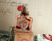 Love Potion No. 9 repurposed vintage bottle and necklace