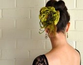 Moss green and rust flower clip with peacock, coque and ostrich feathers. Embellished with brass peacock rhinestone pin. Vintage look.