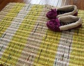 Yellow Upcycled Rug Woven from Plastic Grocery Bags.