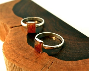 small ring of brandy colored amber set in sterling silver, sizes: 5, 6.5, 8 , 9, 9.5