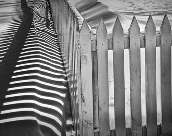 White Picket Fence in Winter by the lighthouse in Whitehall Michigan No.1442BW A Black and White Fine Art Abstract Landscape Photograph