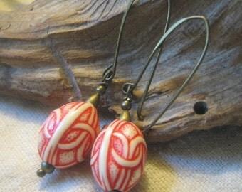 orange-red and ivory long dangle earrings