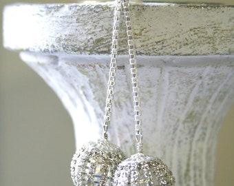 silver rhinestone disco ball drop holiday earrings.