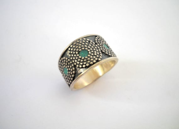 Oxidized Black Silver ring with dotted filigree circles, circular spirals with green centers, Blackened Sterling silver ring by Hila Welner