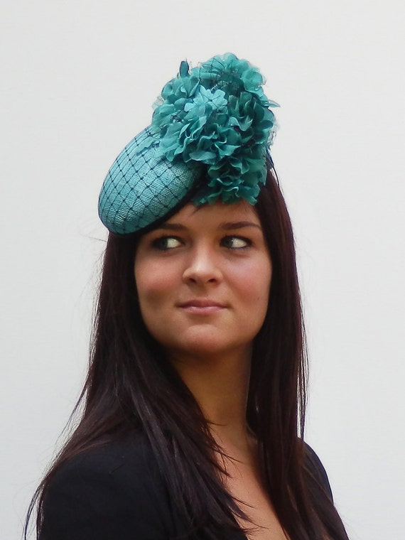 Dutch design    Aqua / Black minihat sinamay with black net covering and lots of flowers on aliceband