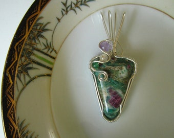 SOLD - Wire wrapped Artisan Pendant of Ruby in Fuschite and Sterling Silver