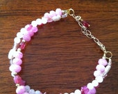 Multi-stone pink double twined bracelet with extension.  Rose quratz, pearls, and glass beads