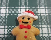 Gingerbread Man with Red Santa Hat Charm