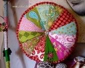 patchwork cushion round with sparkling glassbutton