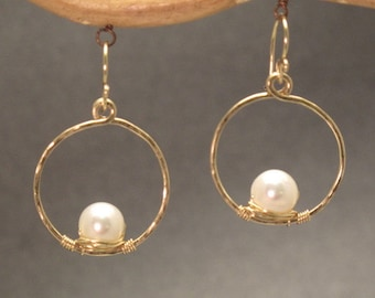 Ivory pearls wrapped inside small circles Cosmopolitan 37