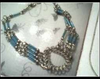 Glass Aqua Tubes And Metal Weaved Bracelet......