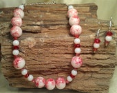 Red and white handpainted porceline beaded necklace with swarovski red ab bicones and red rondelle, partial chain and matching earrings