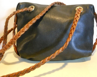 Lovely Italian, vintage blue leather shoulderbag with long braided straps. vg