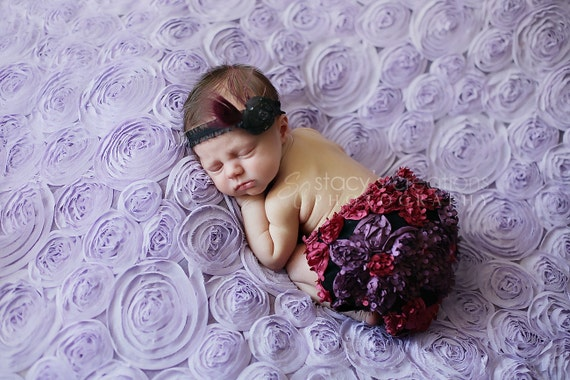 Textured Flower Diaper Cover in Deep Pink and Deep Lilac with Matching peacock fascinator