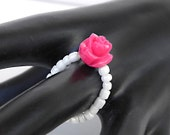 Beaded elastic ring with fuchsia flower, white beads, dainty everyday ring
