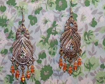 Chunky Chandelier Earrings with Apricot Colored Crystal Beads hanging from a Tibetan Silver Filigree Pendant