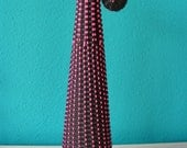 Vintage black and fluorescent pink glass bottle, vase , wickered with nylon wire, 1960s