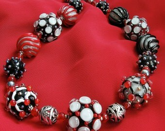 Red and black lampwork glass beaded necklace with metal beads. Goth style.
