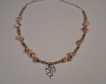 Leaf with Curly Shell Beads