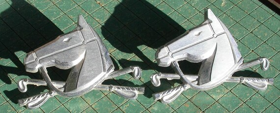 1965 Ford Country Squire horse head Emblems, found art, restoration