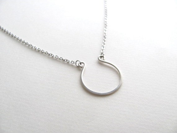 Sterling silver lucky horse shoe charm necklace on delicate silver chain, minimalist