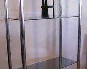 Mid Century Modern Chrome wall unit glass Etagere vintage in the manner of Jerry Johnson Milo Baughman and Karl Springer