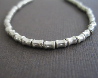 Karen Tribe Fine Silver Flaired Tube Heishi Beads