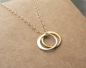 sun and moon - tiny gold and silver circle necklace - minimalist jewelry by windowsill