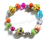 Elephant Charm bracelet with flowers and eclectic colorful beads Pewter rhinestones leather silver accents Pink Orange Yellow Lime Turquoise