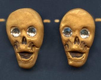 4 Polymer Golden Laughing  Skull beads with Swarovski  rhinestone eyes SKBS 4  Side Drilled