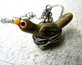 Glass lampwork bird in a soldered wire nest necklace