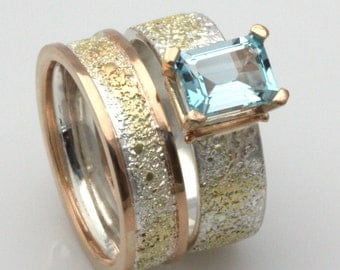Blue Topaz Ring set, 18k gold and sterling silver