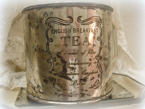 vintage silver plated english breakfast tea tin . round with engraving . much patina . antique reproduction