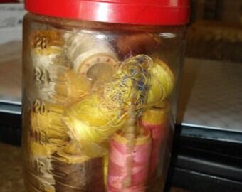 Jar of Thread Spools