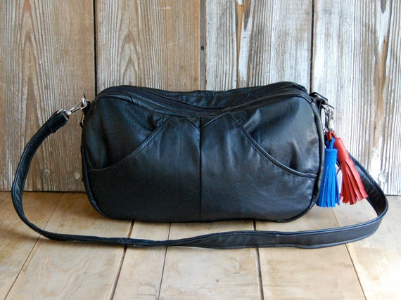 FURROW /// black leather slouchy bag with red and blue tassel