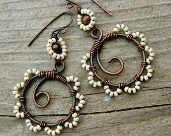 Bead Dance earrings - seed bead wire wrapped antiqued copper hoops with beaded petals in Cream Pearl