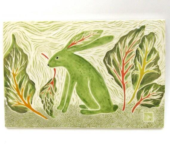 ceramic art tile rabbit in garden