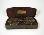 Vintage spectacles, glasses, bi-focal in original leather box - photo shoot prop