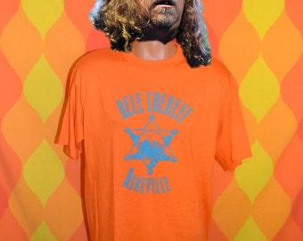 vintage t-shirt 80s bele chere ASHEVILLE sheriff music street festival tee Large orange