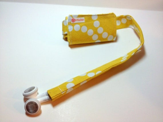 TuneTube.  iPhone/iPod headphone/ear bud cord organizer.  Yellow with white dots.