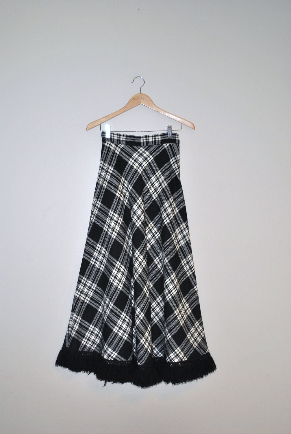 Black and white chevron maxi skirt - The staple maxi skirt! Super cute and comfortable. Black with white chevron stripes. High-waisted but band can be folded over as shown. Stretchy and flowy. Size large. Never worn, no flaws. Message me with questions! Price negotiable.