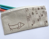 sausage dog pencil case. chocolate brown embroidery with little houses fabric