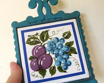 Vintage Ceramic Tile Cast Iron Trivet Blue and Purple Fruit