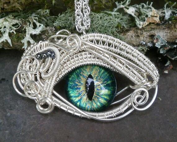 Gothic Steampunk Evil Eye Pendant in blue green glass eye